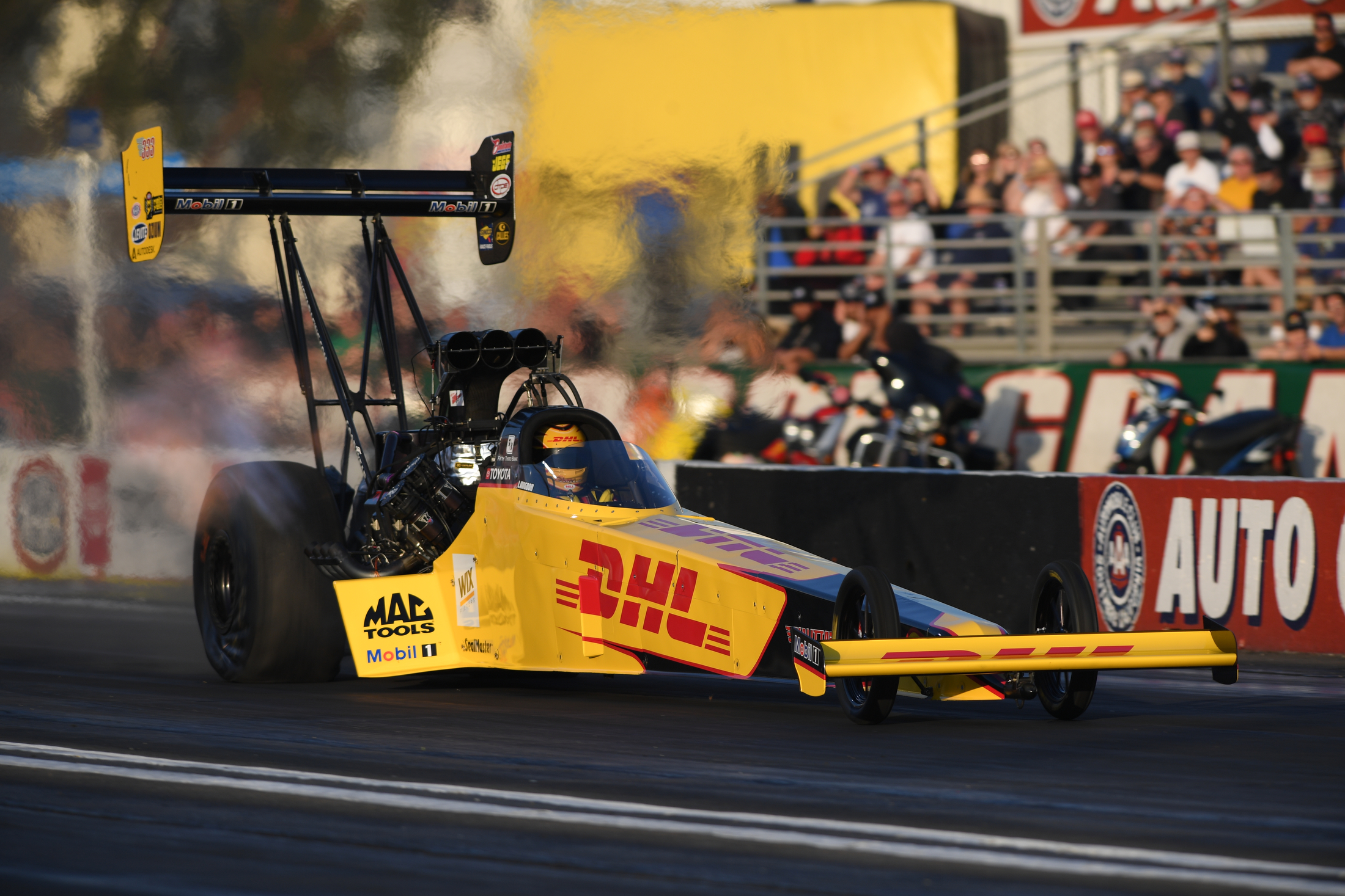 DHL Top Fuel Dragster pilot Shawn Langdon racing on Friday at the 60th annual Lucas Oil NHRA Winternationals presented by ProtectTheHarvest.com