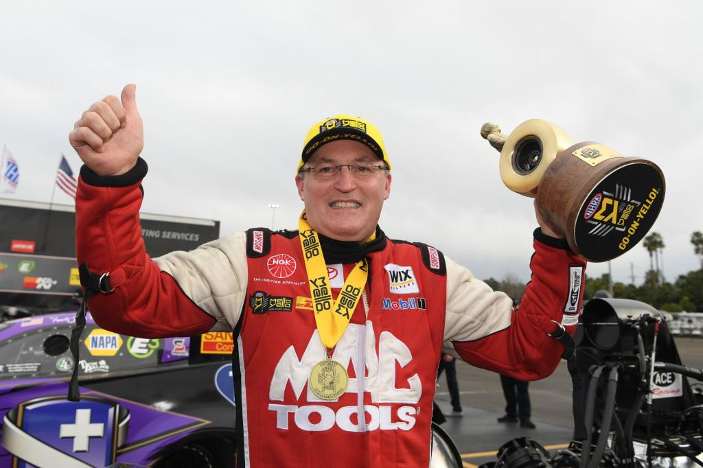 Mac Tools Top Fuel Dragster pilot Doug Kalitta with the Wally on Sunday after winning the 60th annual Lucas Oil NHRA Winternationals presented by ProtectTheHarvest.com