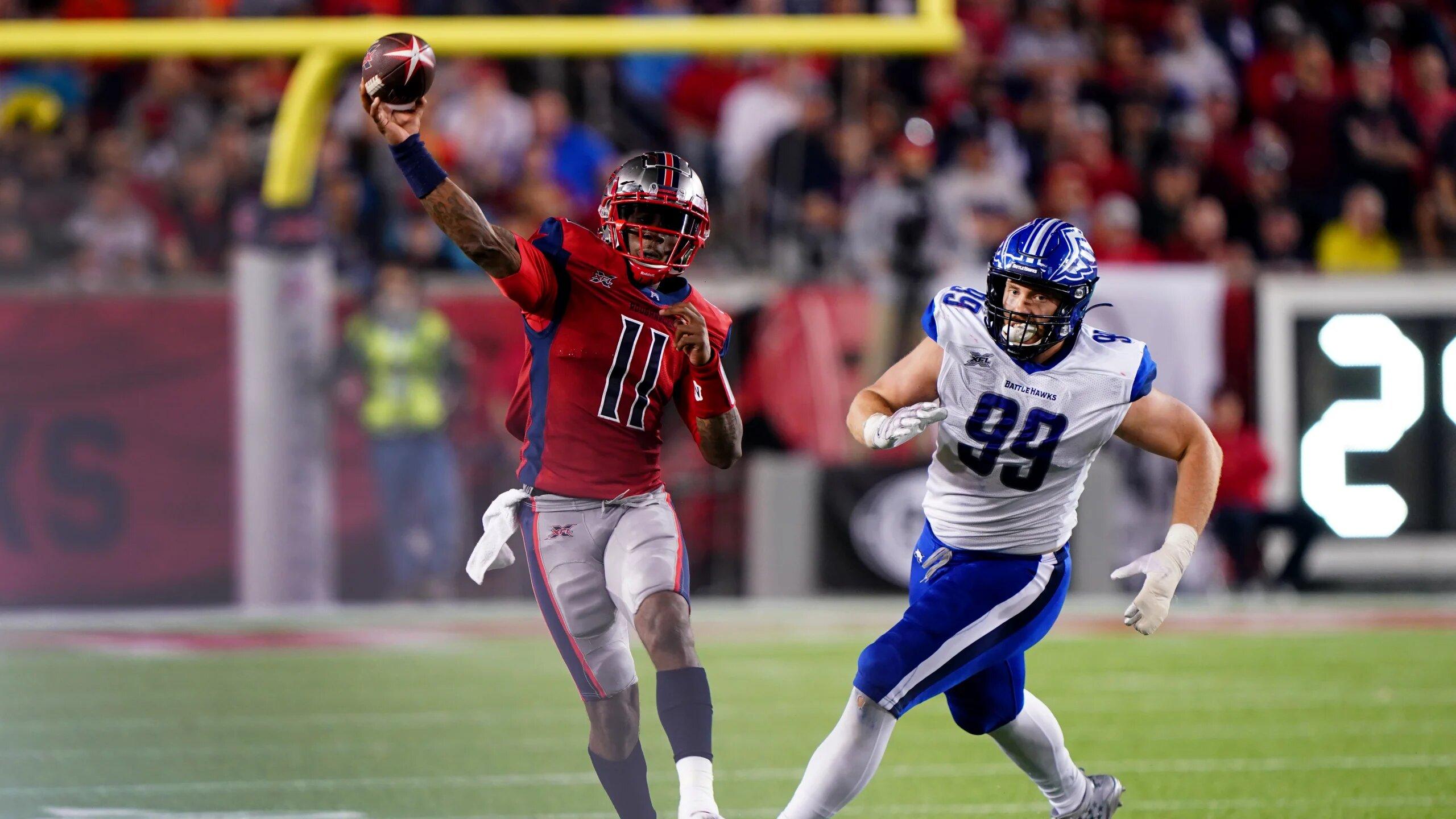 Houston Roughnecks quarterback P.J. Walker attempting a pass against the St. Louis BattleHawks