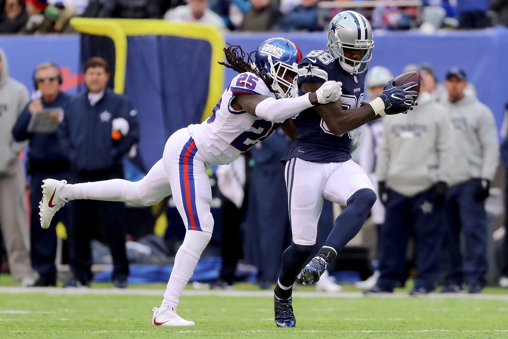 Former Dallas Cowboys wide receiver Dez Bryant catches a pass as Brandon Dixon attempts to tackle him against the New York Giants for what would be a 50-yard touchdown reception