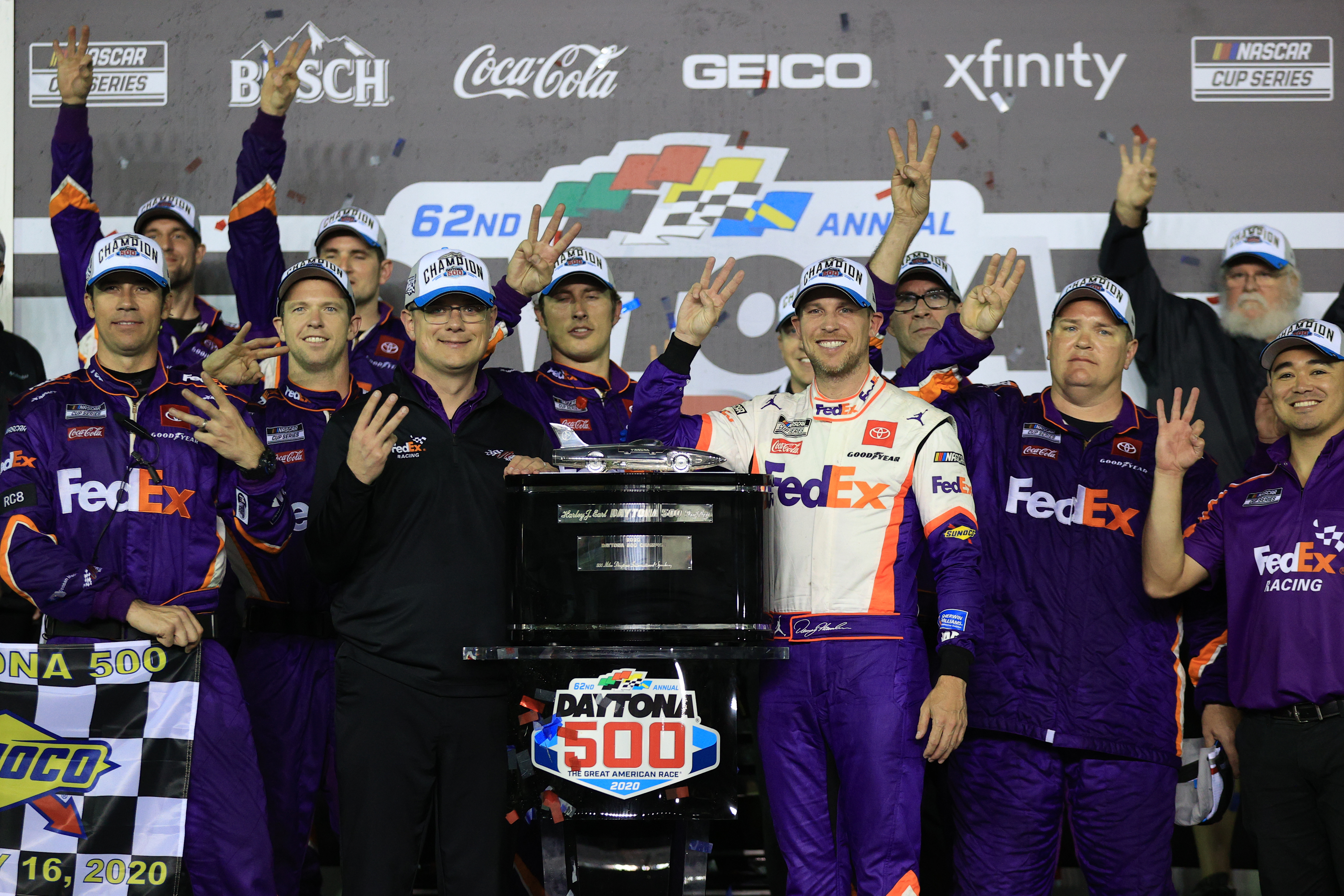 FedEx driver Denny Hamlin celebrates in Victory Lane after winning the NASCAR Cup Series 62nd annual Daytona 500