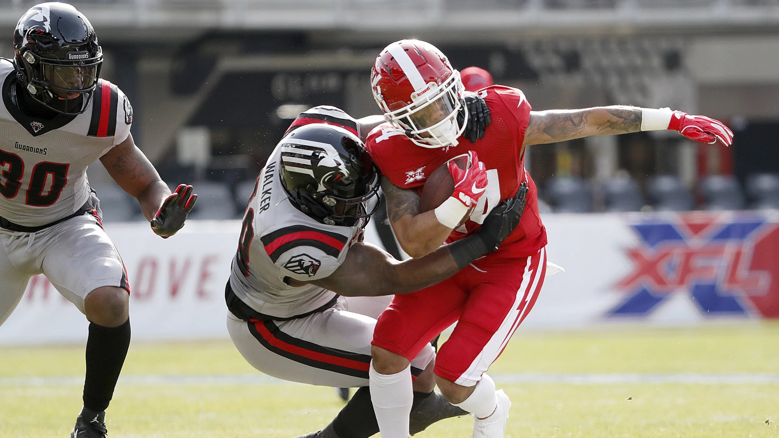 DC Defenders running back Donnel Pumphrey is tackled by the New York Guardians