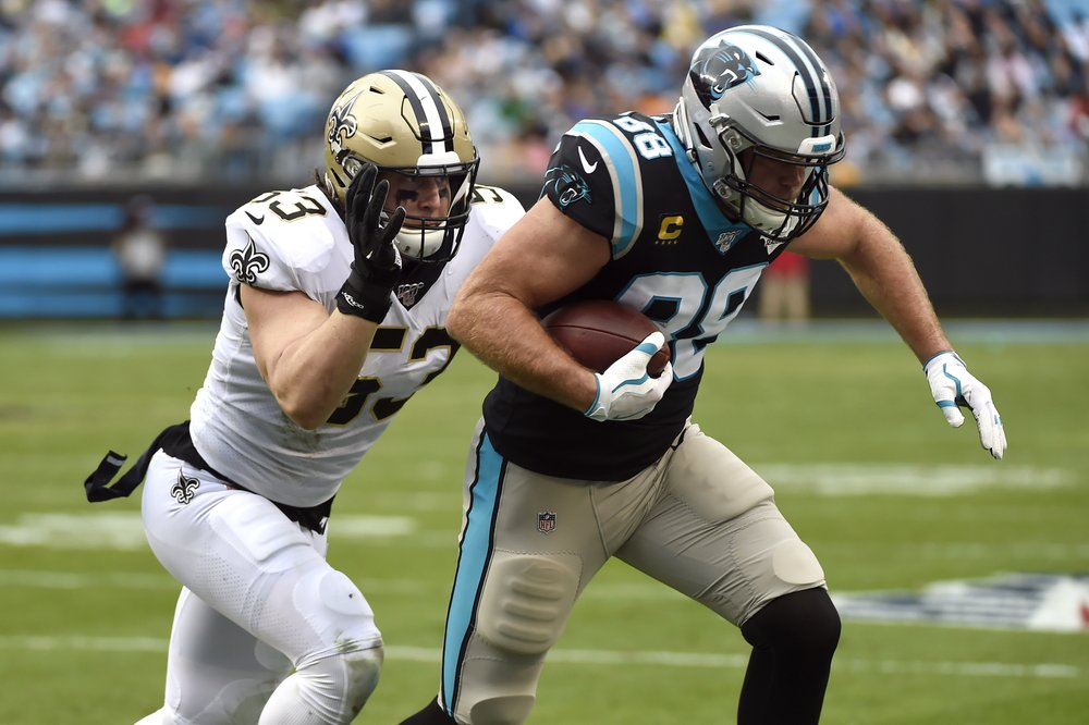 Former Carolina Panthers tight end Greg Olsen tries to evade a tackle by A.J. Klein against the New Orleans Saints
