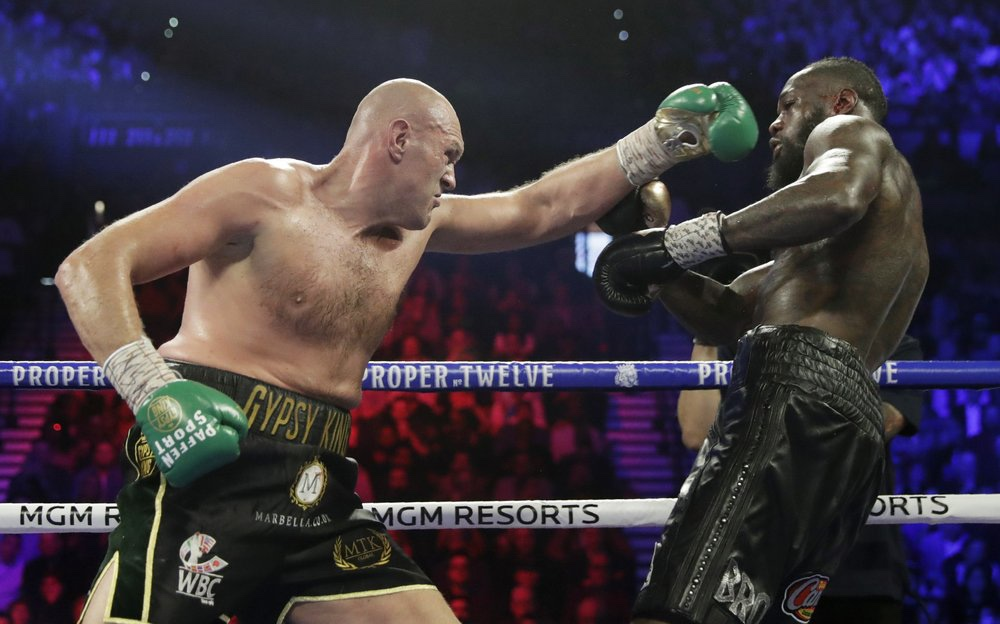 Heavyweight boxer Tyson Fury fights Deontay Wilder during a WBC heavyweight championship boxing match