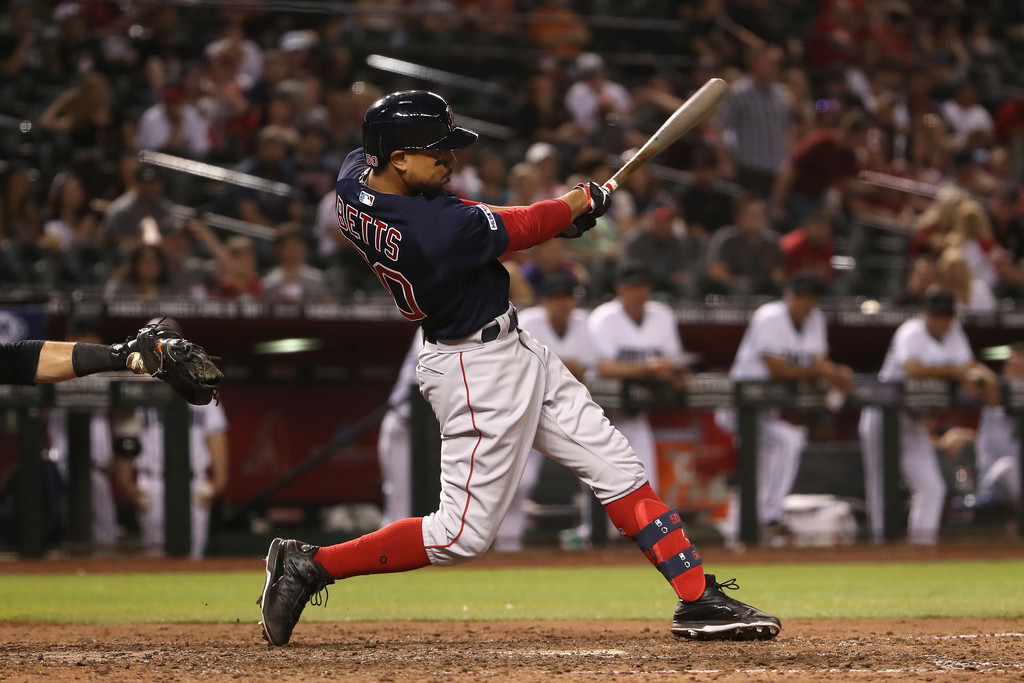 Former Boston Red Sox outfielder Mookie Betts swings the bat against the Arizona Diamondbacks