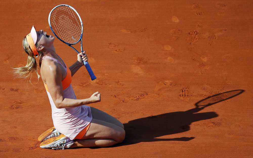 Tennis star Maria Sharapova reacts after defeating Simona Halep during the French Open