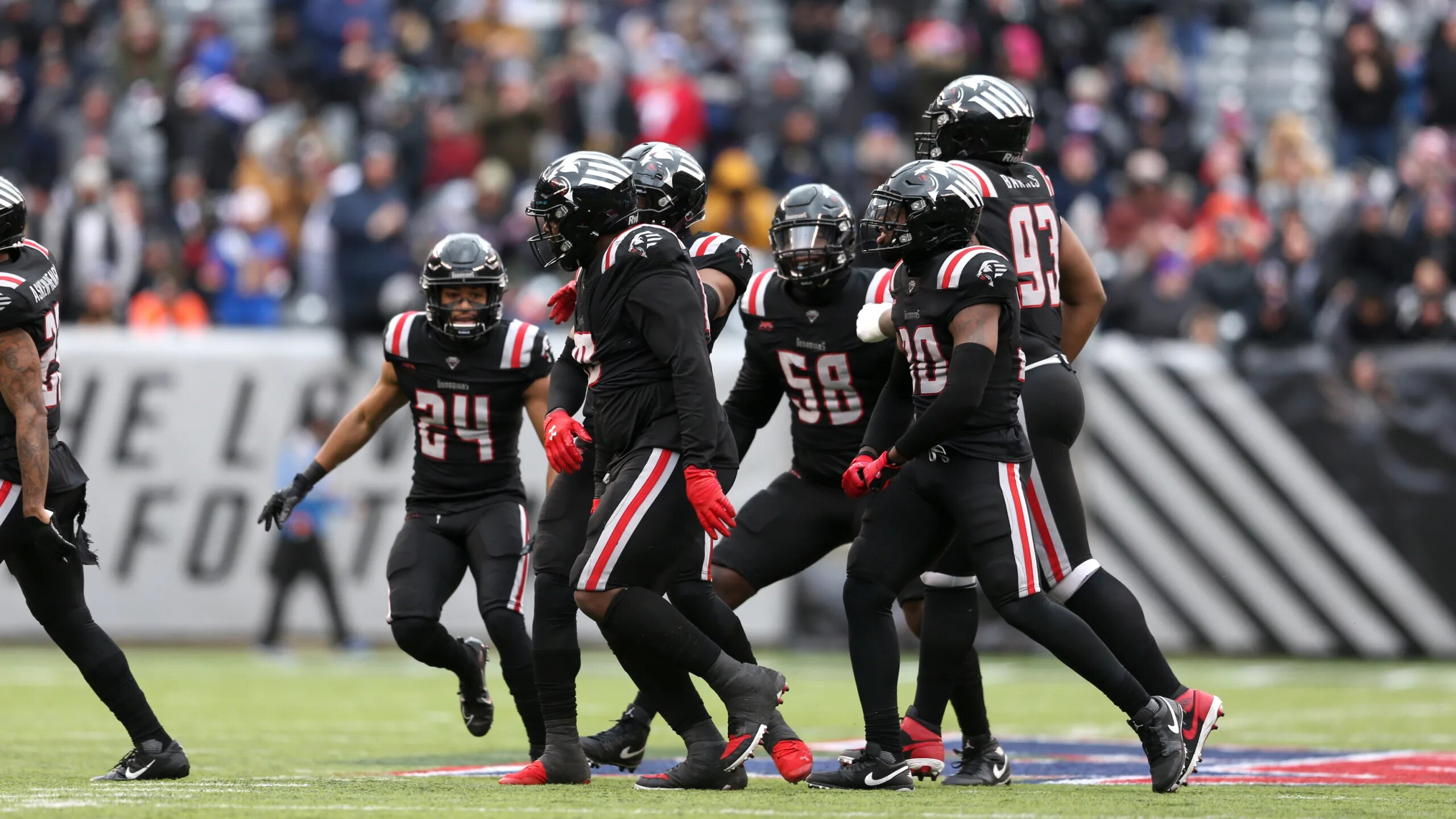New York Guardians defense celebrates after a play in their win over the Los Angeles Wildcats