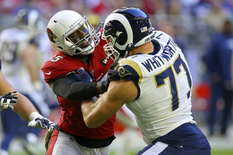 Los Angeles Rams tackle Andrew Whitworth battles with Arizona Cardinals defensive end Chandler Jones