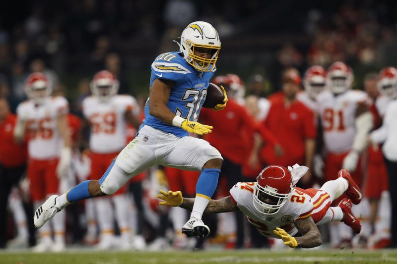 Los Angeles Chargers running back Austin Ekeler avoids a tackle by Jordan Lucas against the Kansas City Chiefs