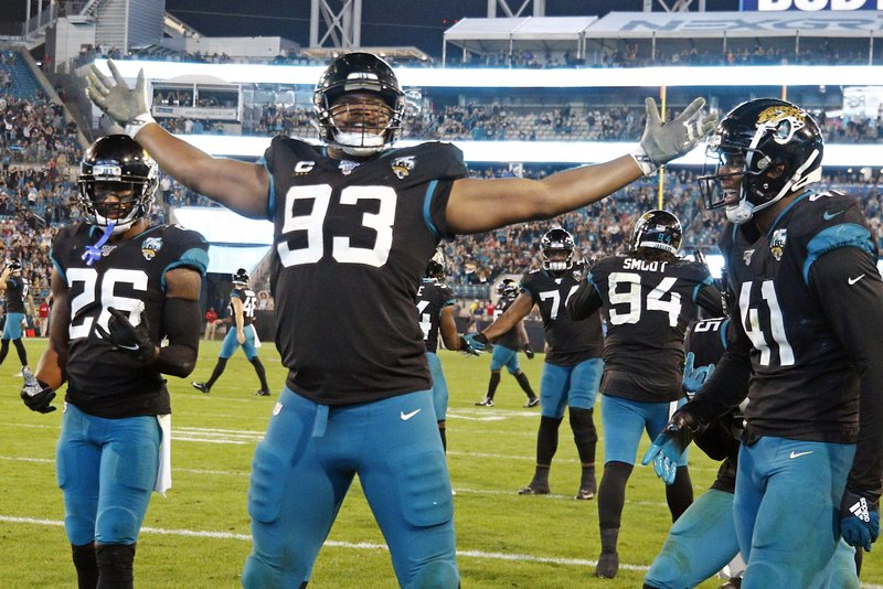 Former Jacksonville Jaguars defensive end Calais Campbell celebrates a touchdown against the Indianapolis Colts