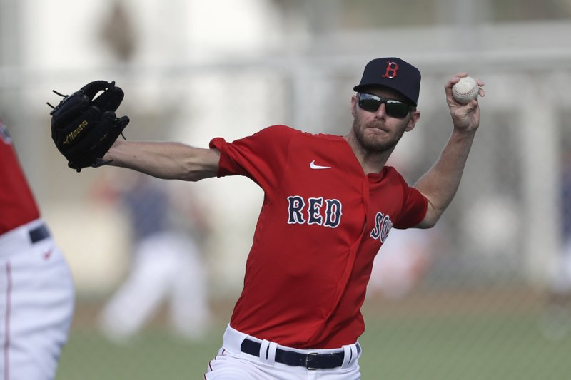 Boston Red Sox ace Chris Sale throws a baseball during spring training during camp