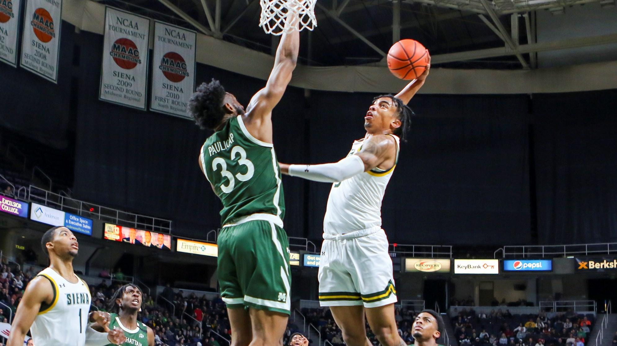 Siena Saints swingman Manny Camper attempting a dunk against the Manhattan Jaspers