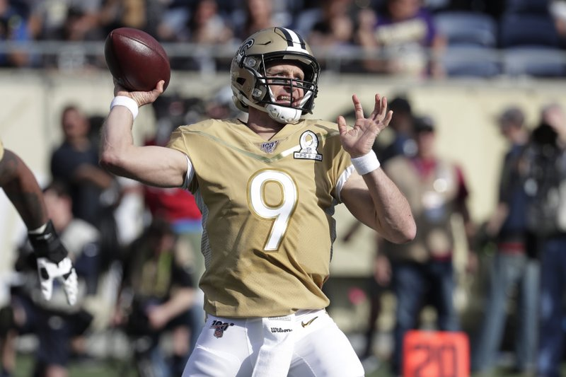 New Orleans Saints quarterback Drew Brees – seen here representing the NFC during the Pro Bowl – looks to pass throw the football