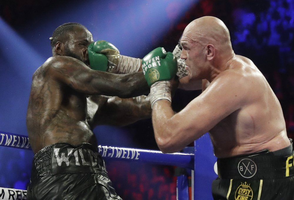 Tyson Fury lands a right to Deontay Wilder during a WBC heavyweight championship boxing match