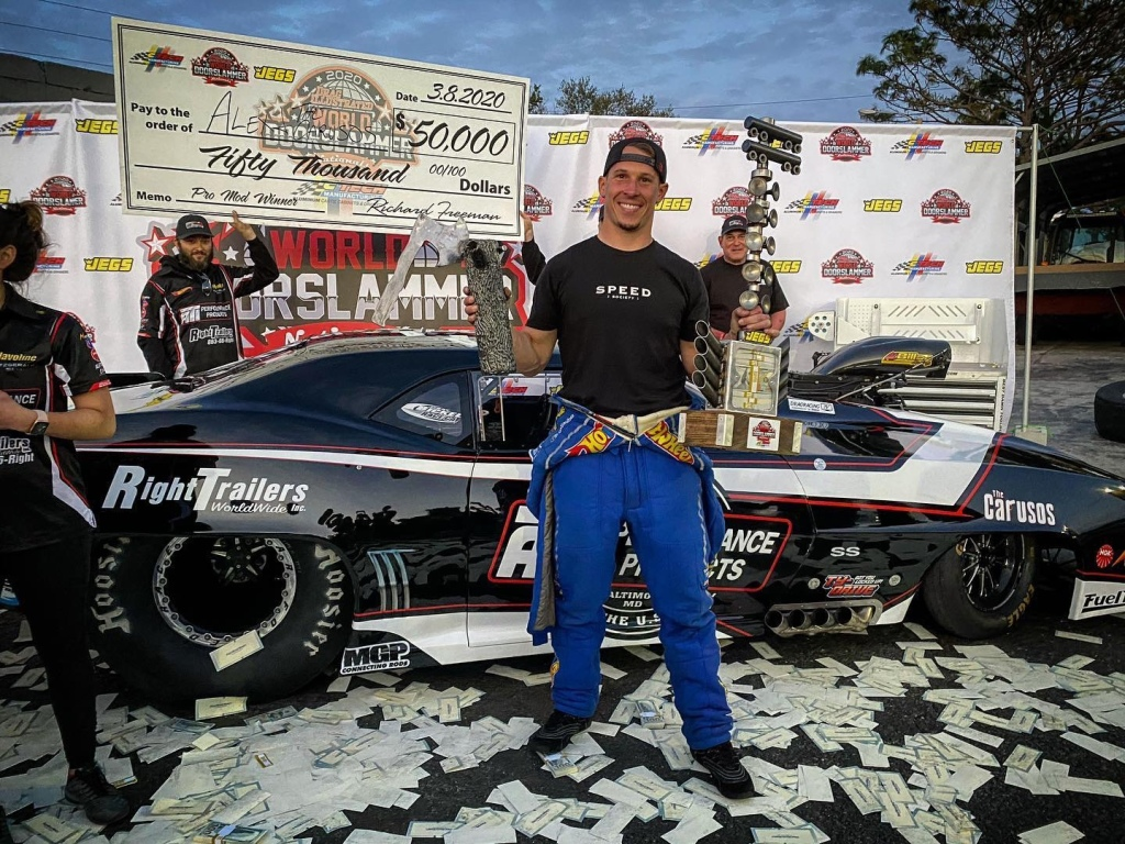 Doorslammer driver Alex Laughlin celebrating after winning the Pro Mod final at the World Doorslammer Nationals