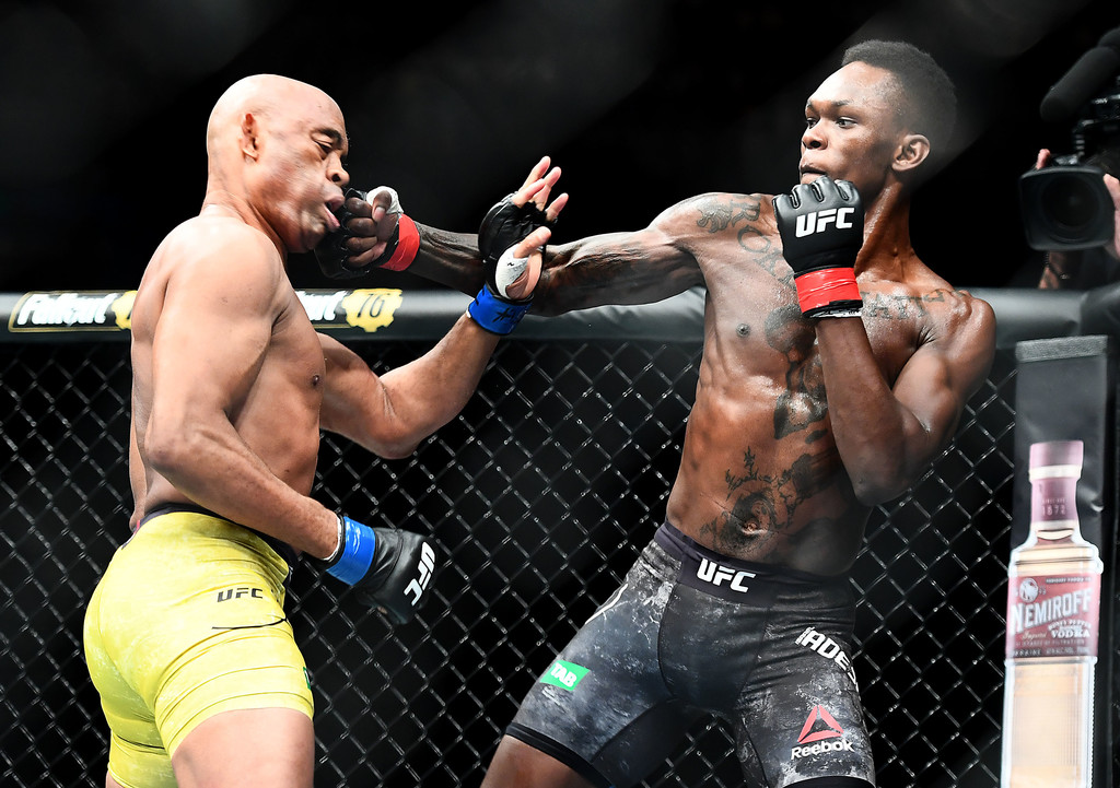 Isreal Adesanya punches Anderson Silva during their middleweight fight at UFC 234