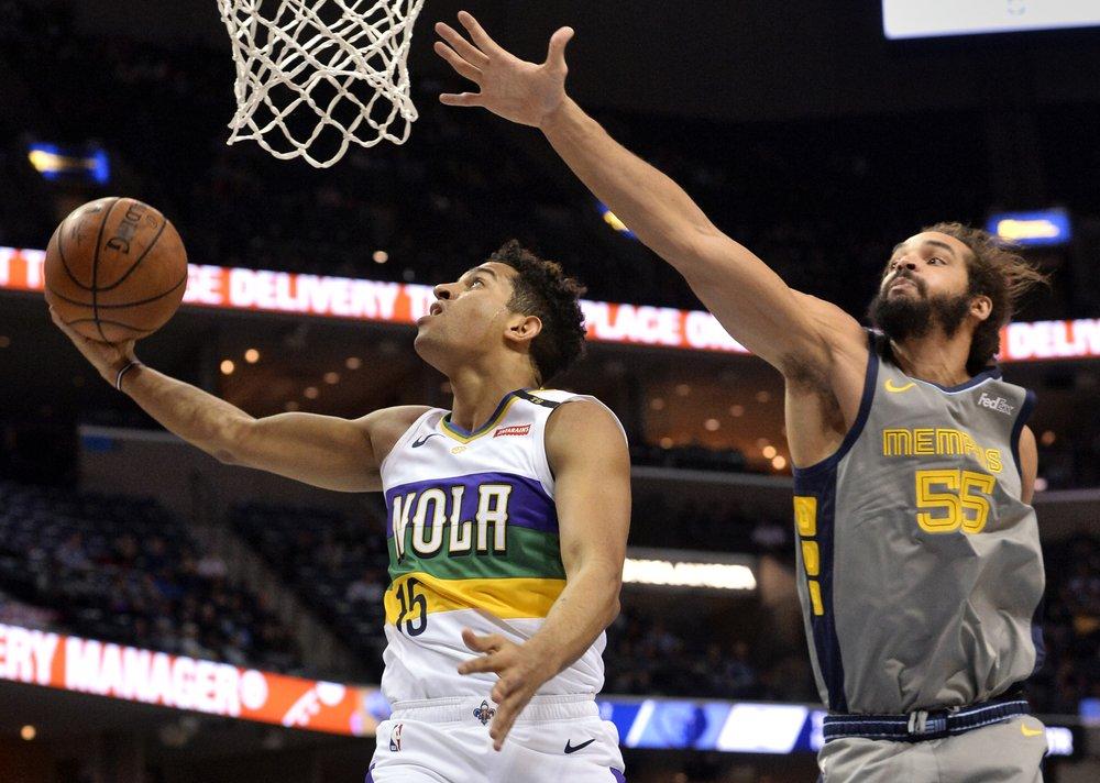 Former Memphis Grizzlies big man Joakim Noah attempts to block Frank Jackson's shot against the New Orleans Pelicans