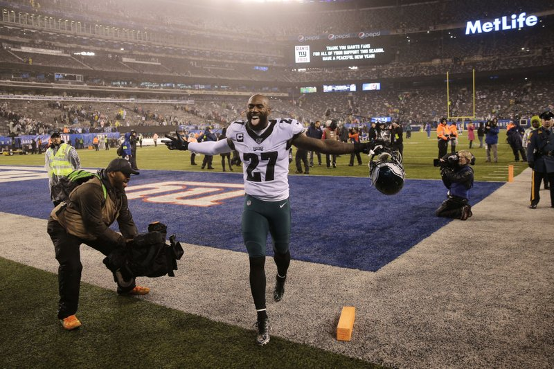 Former Philadelphia Eagles safety Malcolm Jenkins celebrates beating the New York Giants