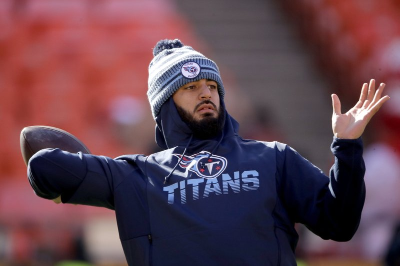 Former Tennessee Titans quarterback Marcus Mariota warms up against the Kansas City Chiefs before the AFC Conference Championship game