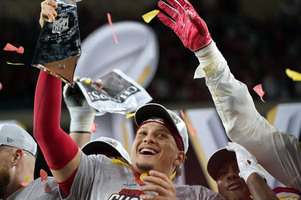 Kansas City Chiefs quarterback Patrick Mahomes hoists the Lombardi Trophy into the air after defeating the San Francisco 49ers in Super Bowl 54