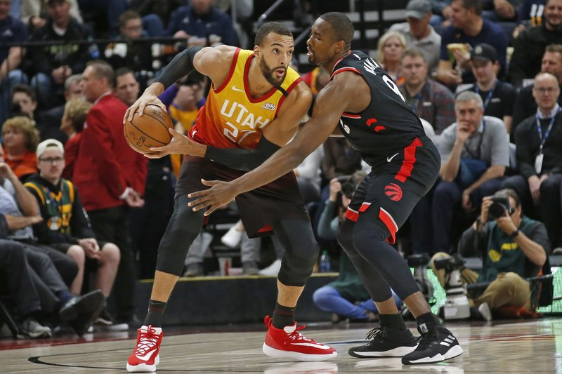 Utah Jazz center Rudy Gobert guards Toronto Raptors center Serge Ibaka during their NBA game