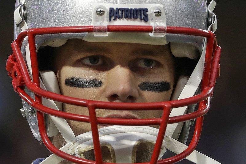 Former New England Patriots quarterback Tom Brady warms up before Super Bowl 52 against the Philadelphia Eagles