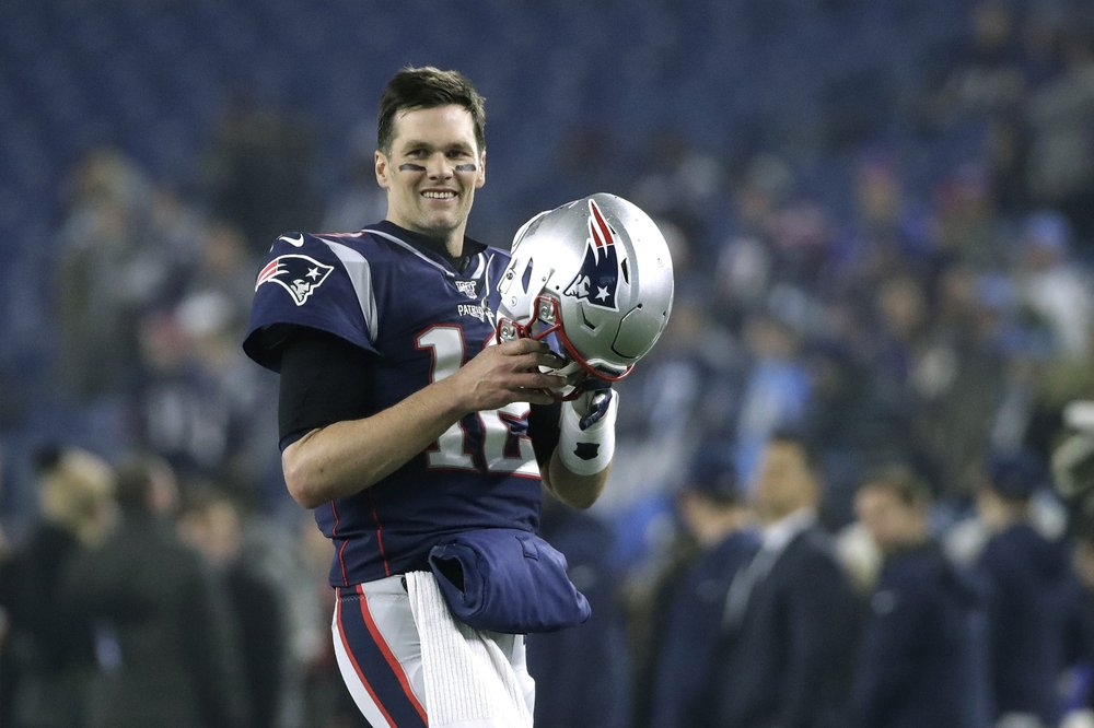Former New England Patriots quarterback Tom Brady warms up before his NFL Wild Card round playoff game against the Tennessee Titans
