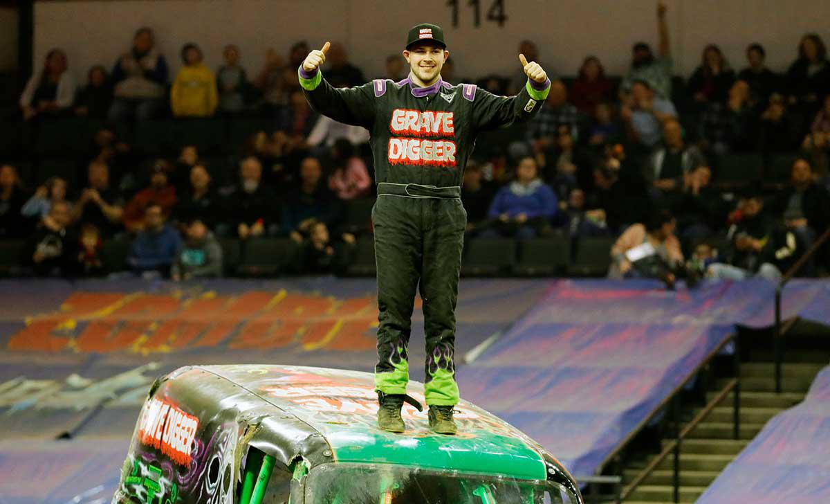 Grave Digger Monster Truck driver Tyler Menniga celebrating his fourth straight Triple Threat Series East Championship