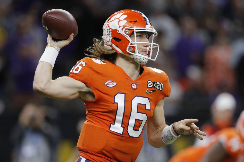 Clemson Tigers quarterback Trevor Lawrence attempts a pass against the LSU Tigers in the College Football Playoff National Championship game
