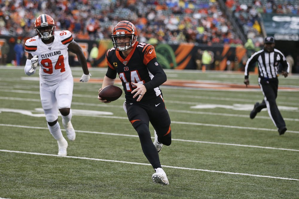 Former Cincinnati Bengals quarterback Andy Dalton rushes for a five-yard rushing touchdown against the Cleveland Browns