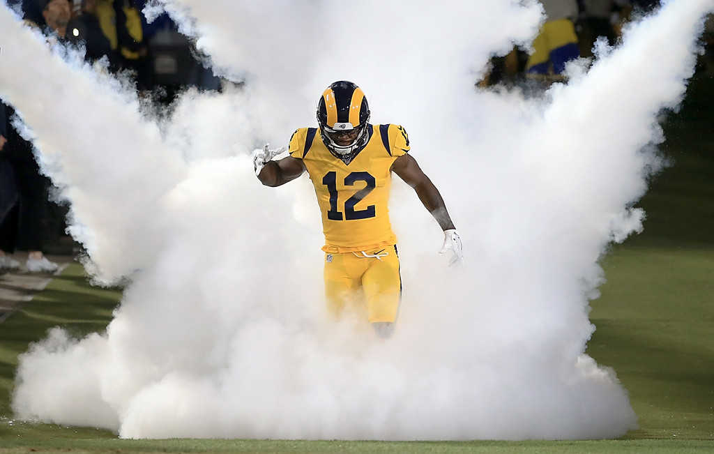 Former Los Angeles Rams wide receiver Brandin Cooks runs onto the field before a game against the Baltimore Ravens
