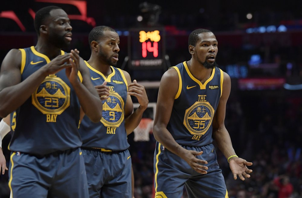 Former Golden State Warriors forward Kevin Durant reacts as he fouled out against the Los Angeles Clippers as Draymond Green and Andre Iguodala look on