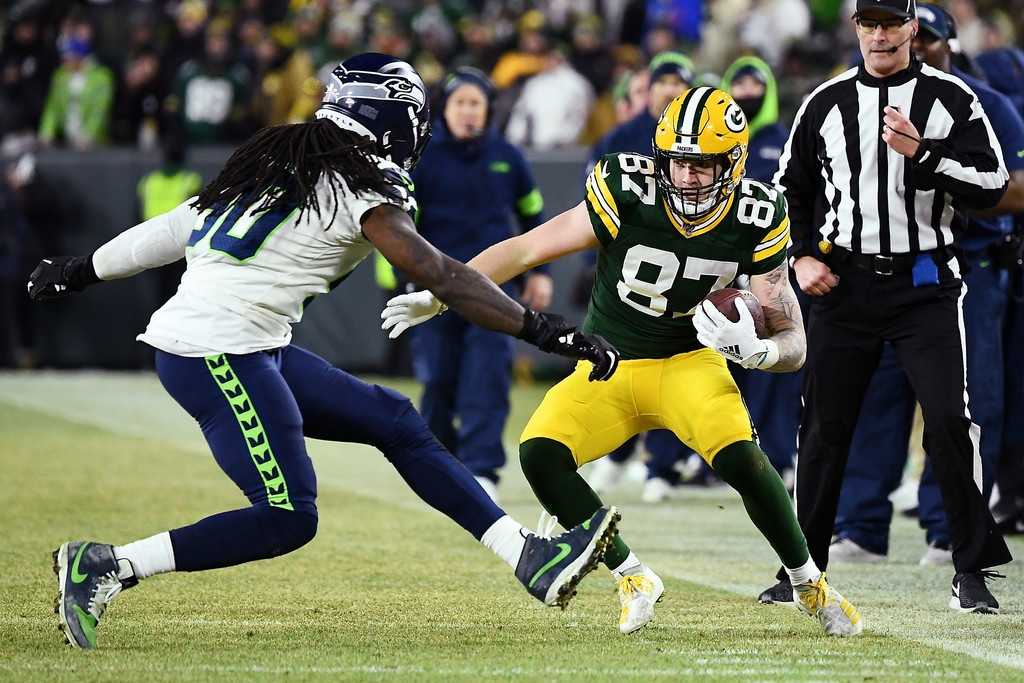 Seattle Seahawks defensive end Jadeveon Clowney looks to tackle Jace Sternberger against the Green Bay Packers in their 2020 NFC Divisional Playoff game