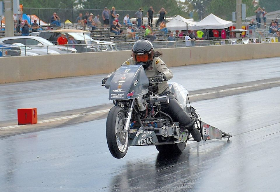 Nitro drag racer Janette Thornley making a pass on a drag strip