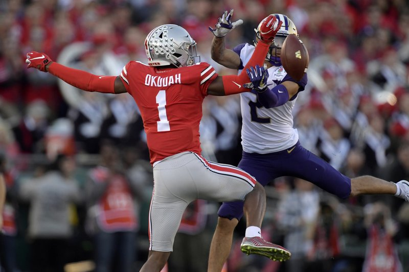 Former Ohio State Buckeyes cornerback Jeffrey Okudah breaks up a pass that was intended for Aaron Fuller against the Washington Huskies in the first half of the 2019 Rose Bowl