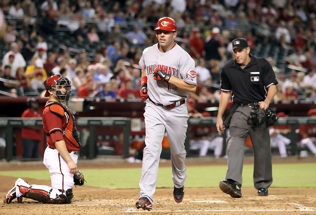 Former Cincinnati Reds outfielder Jim Edmonds crosses home plate after hitting a solo home run against the Arizona Diamondbacks