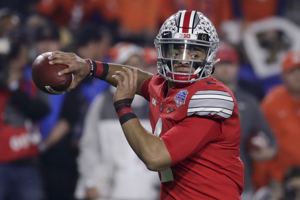 Ohio State quarterback Justin Fields attempts to throw a pass against the Clemson Tigers during the first half of the Fiesta Bowl in the 2019 College Football Playoff Semifinal