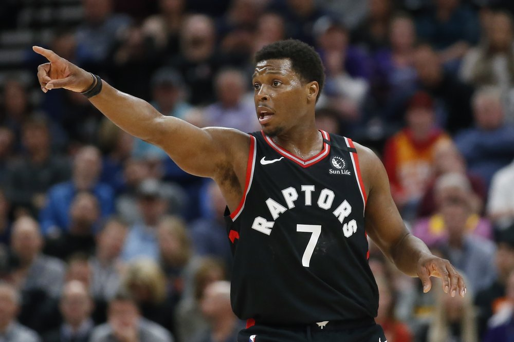 Toronto Raptors point guard Kyle Lowry directs his teammates during a play against the Utah Jazz
