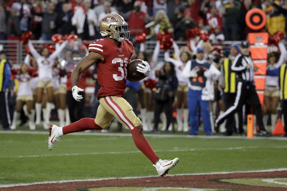 San Francisco 49ers running back Raheem Mostert scores a touchdown in the 2020 NFC Conference Championship game against the Green Bay Packers