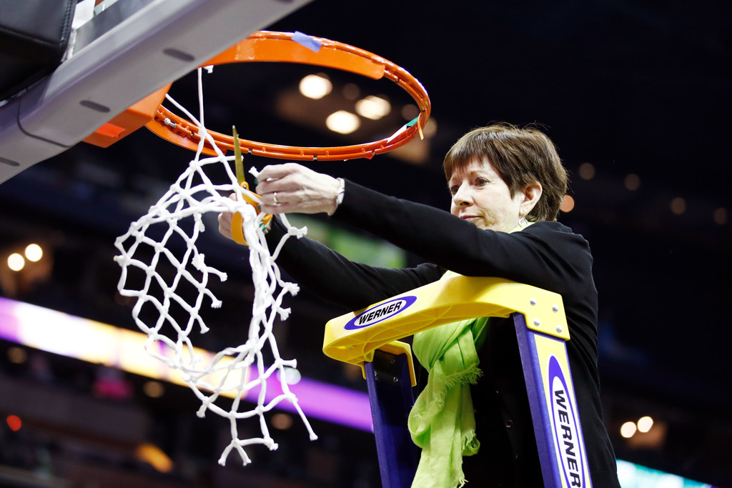 Former Notre Dame women's basketball coach Muffet McGraw cuts down the net after her team defeated the Mississippi State Lady Bulldogs in the NCAA Women's Basketball Championship National Championship game