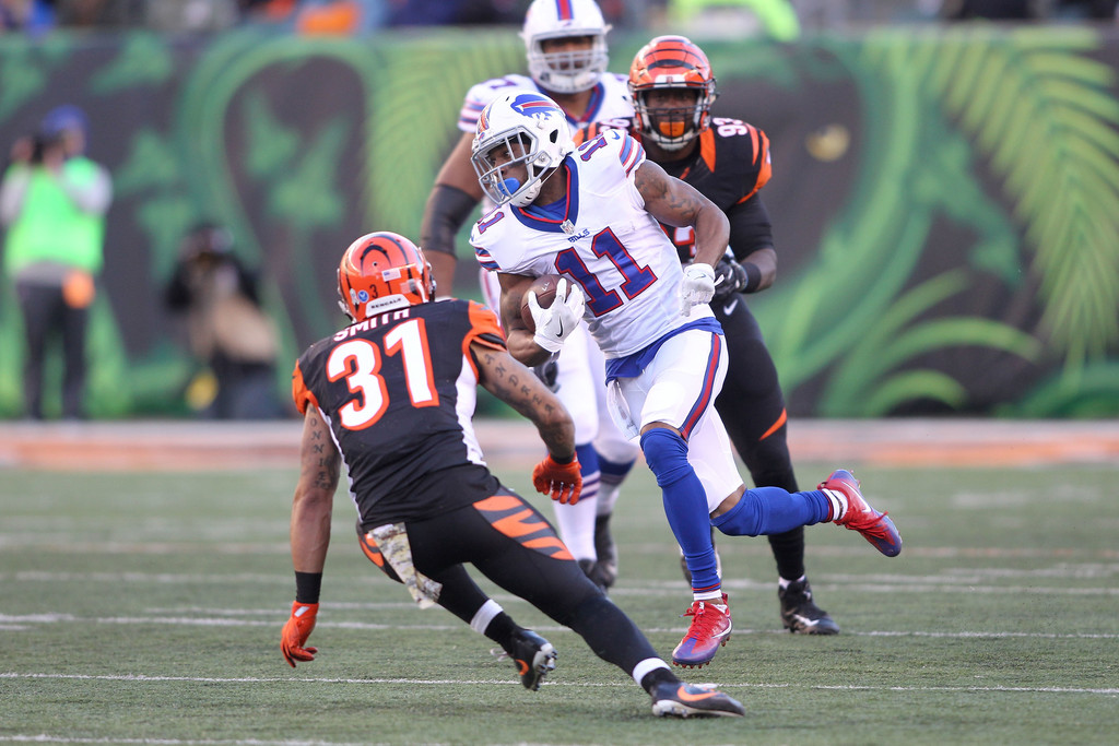 Former Buffalo Bills wide receiver Percy Harvin is trying to avoid a tackle by Derron Smith against the Cincinnati Bengals