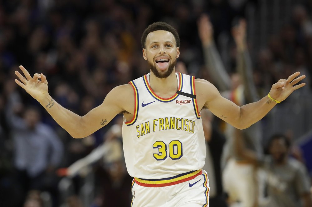 Golden State Warriors star point guard Stephen Curry celebrates after scoring a three-point basket against the Toronto Raptors
