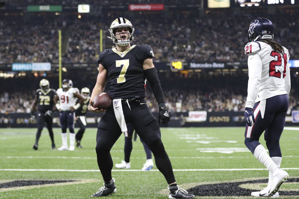New Orleans Saints quarterback Taysom Hill celebrates a touchdown against the Houston Texans