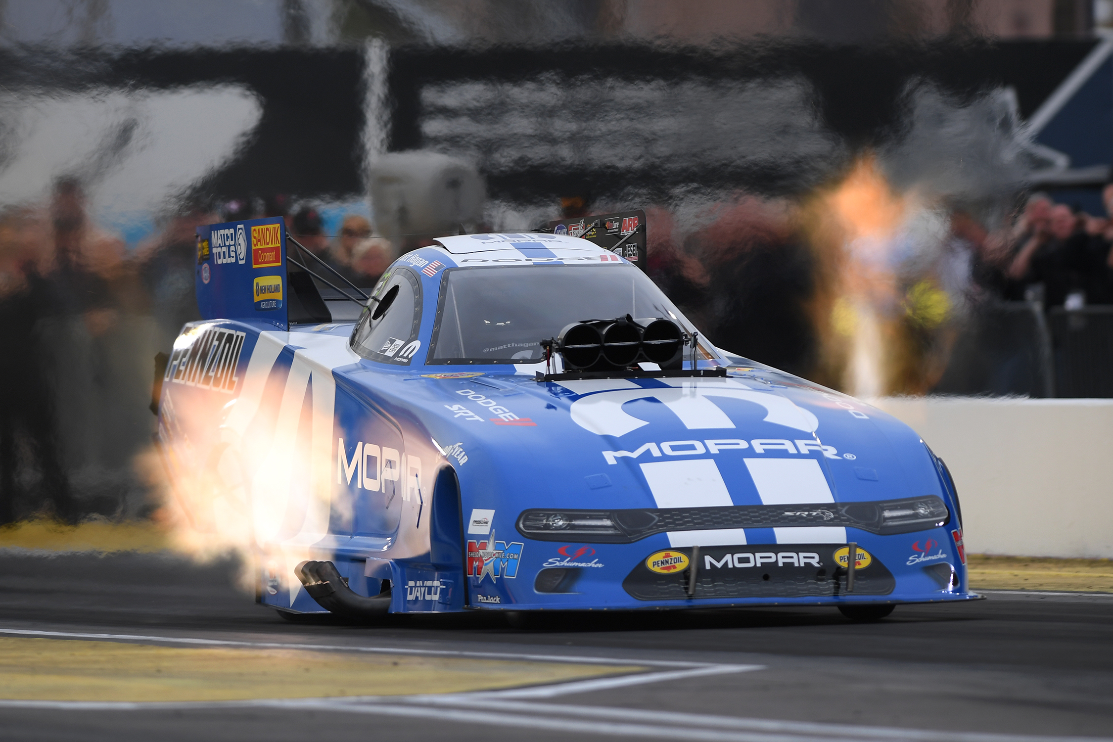 Mopar-sponsored Funny Car pilot Matt Hagan racing on Friday of the NHRA Arizona Nationals