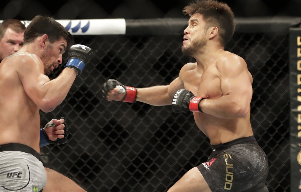 UFC fighter Henry Cejudo punches Dominick Cruz during their UFC 249 co-main event