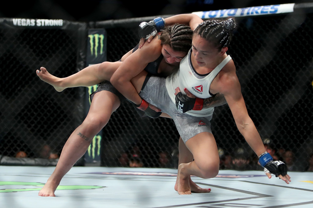 UFC Fighter Claudia Gadelha takes down Carla Esparza in the first round of their strawweight bout at UFC 225