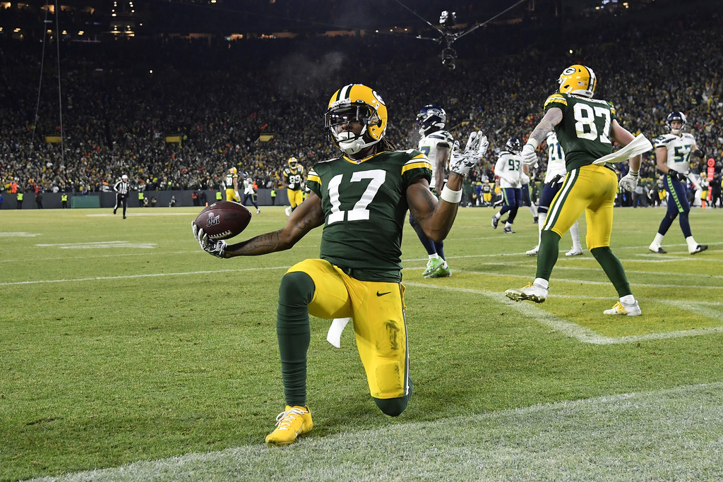 Green Bay Packers wide receiver Davante Adams celebrates a 40-yard touchdown reception against the Seattle Seahawks in the 2020 NFC Divisional Playoff game