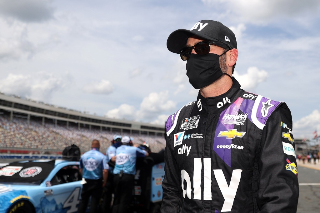 Ally sponsored Jimmie Johnson stands on the grid during qualifying for the NASCAR Cup Series Coca-Cola 600