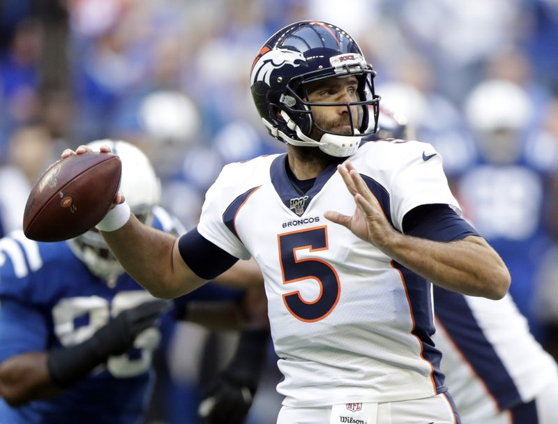 Former Denver Broncos quarterback Joe Flacco attempts a pass against the Indianapolis Colts