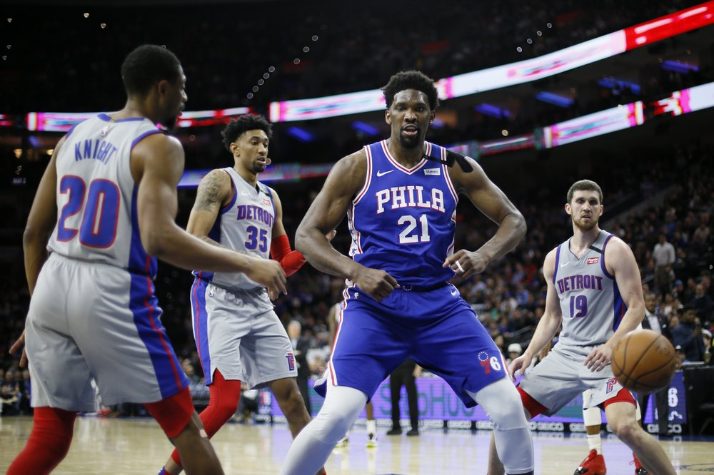 Philadelphia 76ers center Joel Embiid celebrates after scoring a basket against the Detroit Pistons